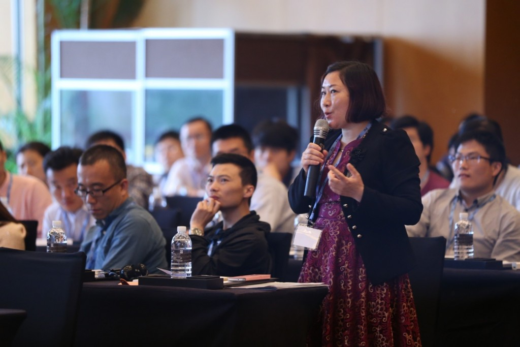 An attendee at Discovery Summit China in Shanghai asks a question during the highly interactive conference.