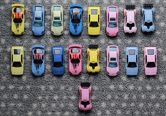 13 diecast cars of different colors