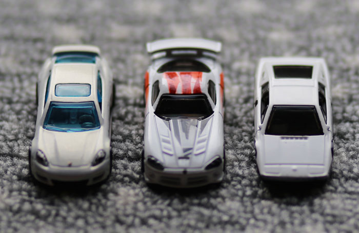 three customized diecast cars