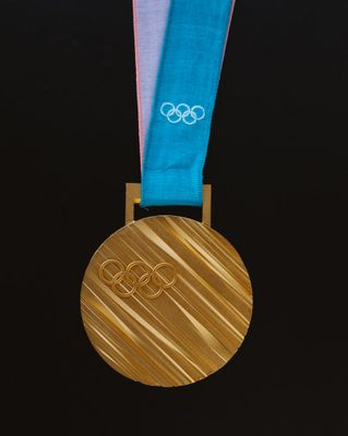Which city gave birth to the most gold medalists?